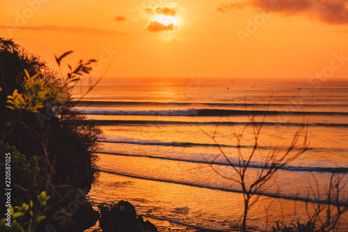 Poster Oranje eclat Colorful warm sunset or sunrise with ocean and perfect waves fo surfing