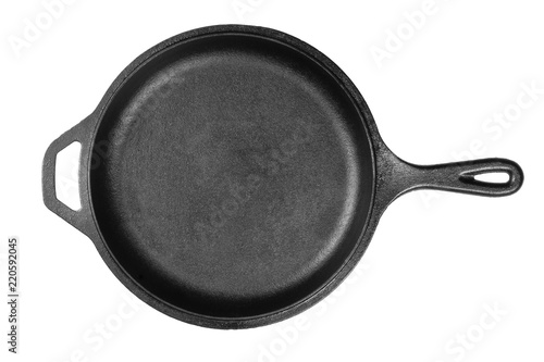 Empty, clean black cast iron pan or dutch oven top view from above over white