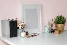 Mockup Poster Frame, Books, Dry Flower And Coffee Mug On White Desk.