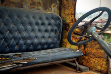 Drivers Seat And Steering Wheel In Old Truck