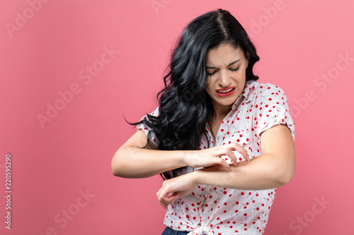 Young woman scratching her itchy arm. Skin problem. Tablou Canvas