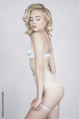 Foto op Canvas womenART Young beautiful blonde in sexy lingerie