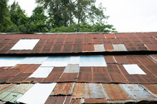 View Of Old Style Zinc Roof With Rust And Lichen With