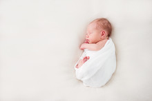 Cute Newborn Baby Lies Swaddle...
