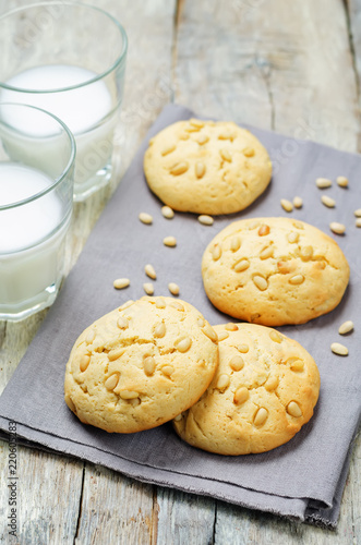 Pine nuts cookies with glasses of milk