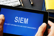 SIEM Security Information And Event Management Program In A Tablet.