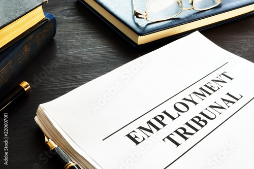 Fototapeta Employment tribunal documents, note pad and glasses.