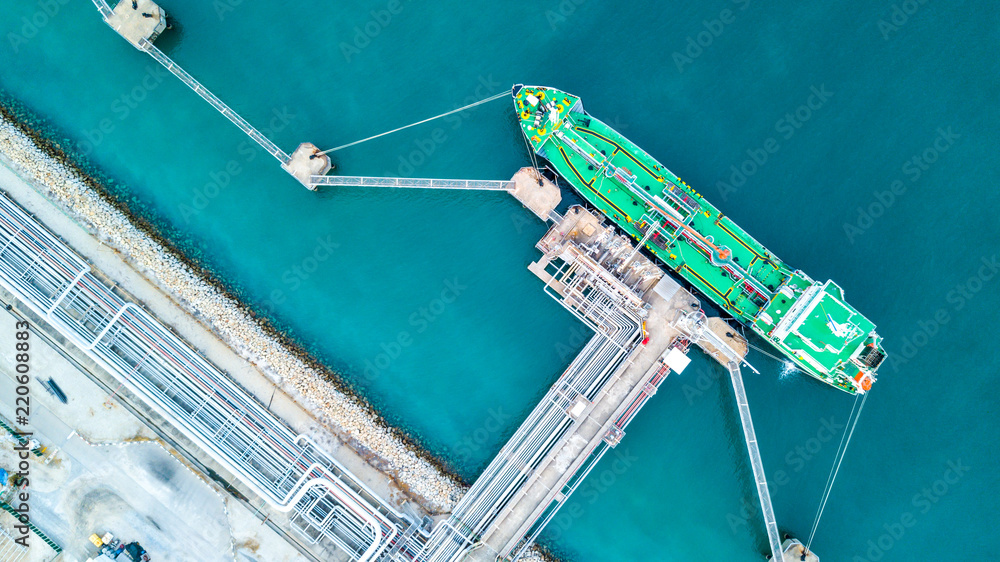 Fototapeta Aerial vie oil tanker ship anchor, Tanker cargo ship boat business operation at oil and gas terminal, View from above.