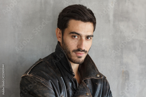 Fotografie, Obraz  Portrait of bearded macho male dressed in brown leather jacket, looking at camer