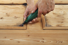 Carpenter Hand Work The Wood With The Rotary Tool