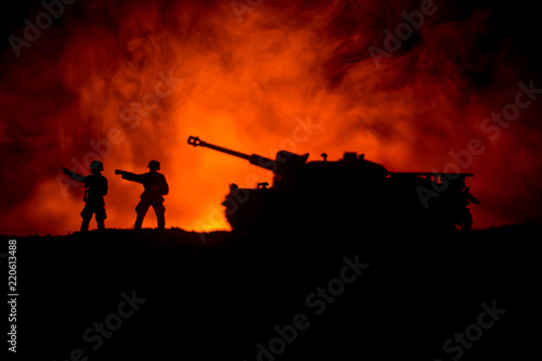 Canvas Prints Military War Concept. Military silhouettes fighting scene on war fog sky background, World War German Tanks Silhouettes Below Cloudy Skyline At night. Attack scene. Armored vehicles.