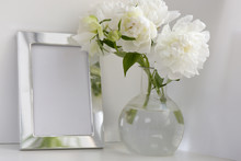White Peony In Glass Vase On W...