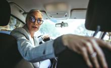 Senor Woman Driving A Car In R...