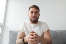 Portrait Of Happy Millennial Man Making Video Call On Laptop Sitting On Couch At Home, Young Mentor Or Trainer Record Online Webinar Or Training, Male Communicate Or Broadcast Live On Computer