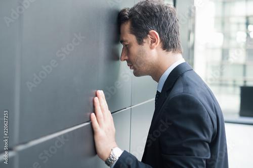 Sad and desperate businessperson in big trouble Wallpaper Mural