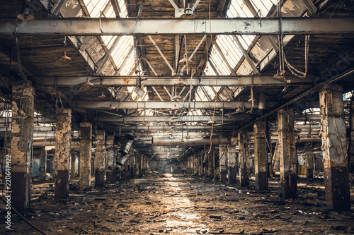 Photo sur Aluminium Les vieux bâtiments abandonnés Abandoned ruined industrial warehouse or factory building inside, corridor view with perspective, ruins and demolition concept