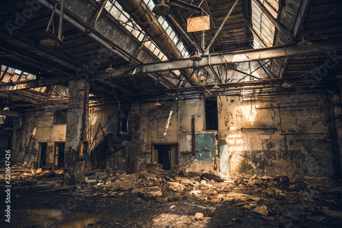 Fotografie, Obraz Abandoned ruined industrial warehouse or factory building inside, corridor view