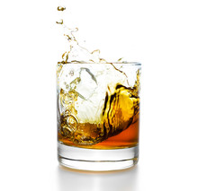 Whisky Glass With Splashes, Isolated On White