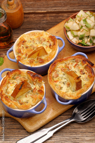 Fotografie, Obraz  Baked pears in puff pastry with nuts on wooden rustic background