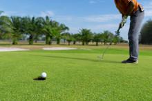 Golfer Putting Golf Ball On Th...