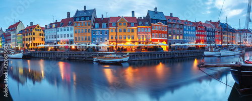 Panorama of north side of Nyhavn with colorful facades of old houses and old ships in the Old Town of Copenhagen, capital of Denmark Wallpaper Mural