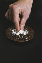 A Man Taking A Pinch Of Salt