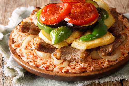 Homemade Iraqi food Makloubi rice with beef and vegetables close-up on a plate. horizontal
