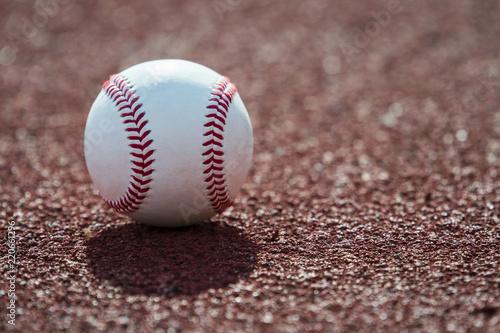 Fotografiet  new baseball ball on red track rubber