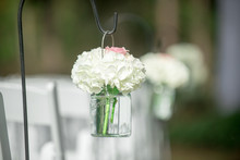 White Flowers In Mason Jars Isle Decor