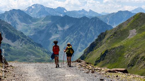 Fototapeta two women hikers on the trail of  Pic du Midi de Bigorre in the Pyrenees obraz