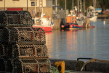 Detail Of Lobster Traps Stacked In A Harbour. Fishing Concept