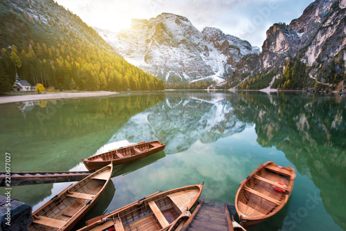 Magical beautiful fairy autumn landscape with boats on the lake on Fanes-Sennes-Braies natural park in the Dolomites in South Tyrol, Alps, Italy, Europe. (holiday, inner peace, harmony - concept)