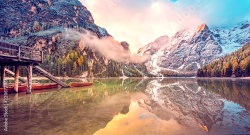 Foto op Plexiglas Cappuccino Magical beautiful fairy autumn landscape with boats on the lake on Fanes-Sennes-Braies natural park in the Dolomites in South Tyrol, Alps, Italy, Europe. (holiday, inner peace, harmony - concept)