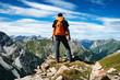 canvas print picture - Mann genießt die Aussicht auf die Alpen vom Gipfel eines Berges