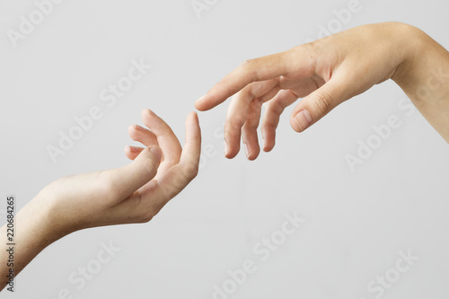 Two fingers reaching out on gray background Wallpaper Mural