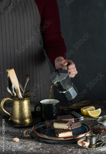 A girl is pouring mocha into a cup
