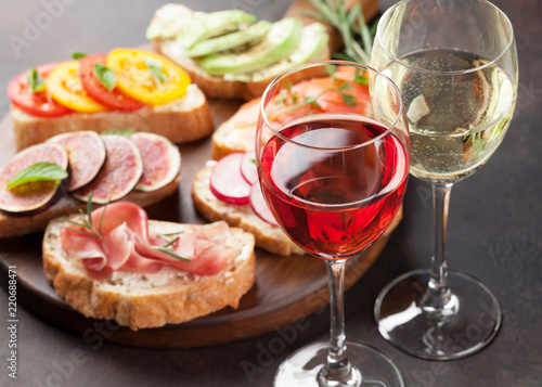 Brushetta or spanish tapas set with wine