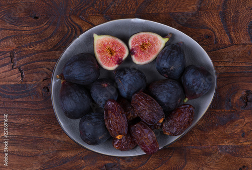 fresh figs and dates on a wooden table