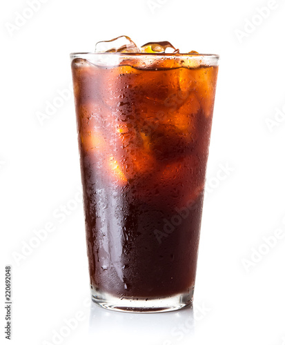 Glass of ice black tea isolated on white