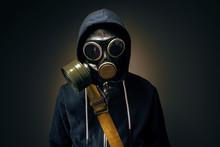 Businessman Wearing Gas Mask In The Dark