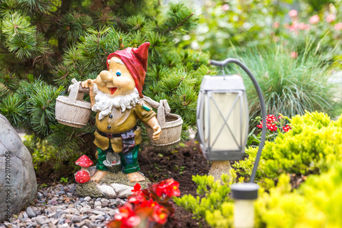 garden dwarf in home garden, gnome decoration Canvas Print