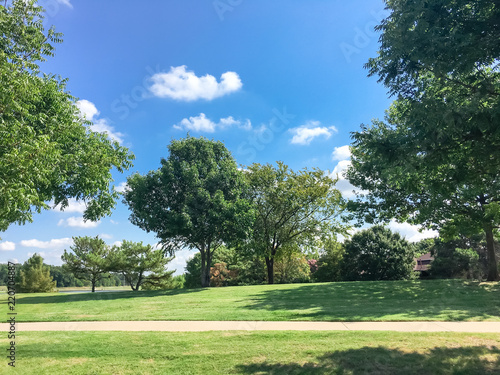 Beautiful grassy lawn park with trail pathway system near suburban residential houses in Coppell, Texas, USA Canvas-taulu
