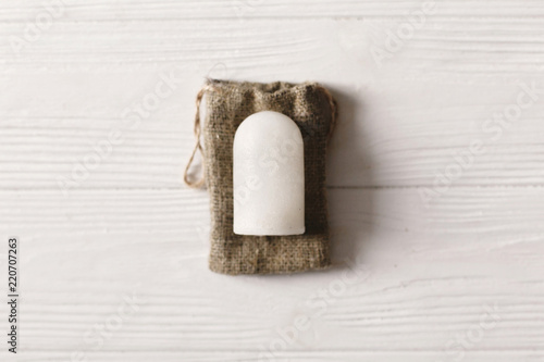 Photo eco natural crystal alunite deodorant flat lay on rustic background