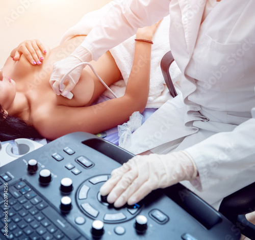 Valokuva Gynecologist performing breast examination for her patient using ultrasound scanner