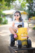 Cute Asian Little Girl Wear Su...