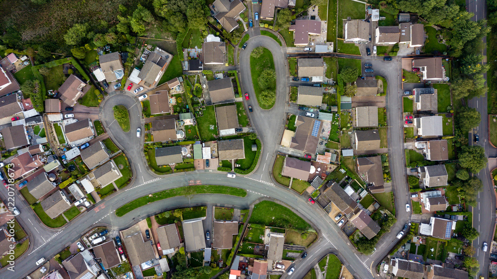 Fototapeta Top down aerial view of urban houses and streets in a residential area of a Welsh town