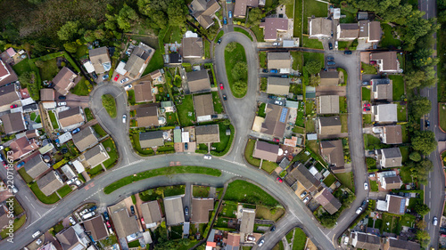 Fototapeta Top down aerial view of urban houses and streets in a residential area of a Wels