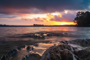 Fototapeta Sunrise / Sunset over a rocky lake