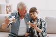 Leinwandbild Motiv Portrait Grandpa and Grandson Playing with Toys