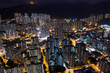 Drone fly over Hong Kong residential area at night